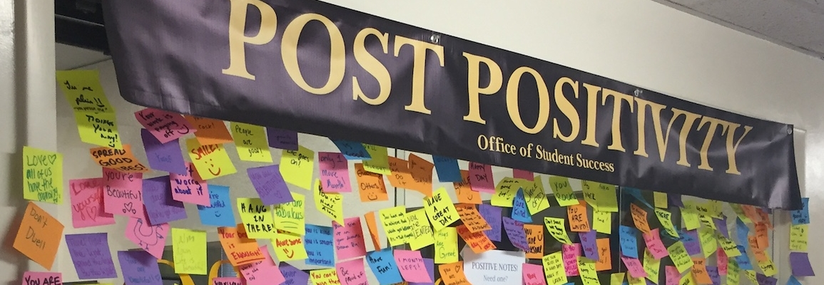 Post Positivity board with post-it messages at the Office of Student Success
